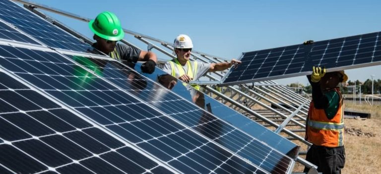 Workers building solar panel; how are solar panels made; pv panels